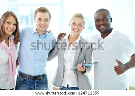 Portrait of four business partners looking at camera with smiles
