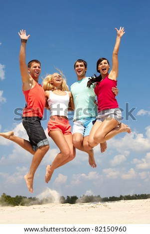 Portrait of four jumping happy people