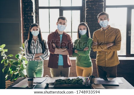 Portrait of four nice attractive successful healthy people leaders IT specialists HR recruiters folded arms wearing gauze mask healthcare stop infection mers cov ncov at workplace workstation