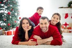 Portrait of four nice attractive sweet peaceful cheerful affectionate big full foster family mom dad celebrating newyear december tradition enjoying rest relax light white interior living-room