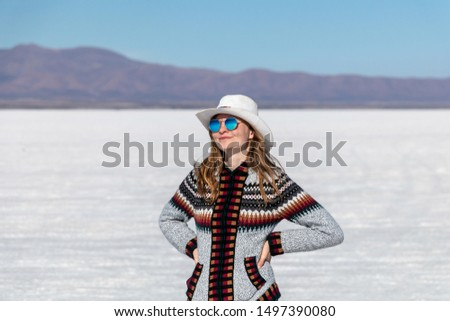 Portrait of free happy woman enjoying nature outdoors vocation. Freedom, travelling and enjoyment concept of beautiful Caucasian girl in her 20s. Image from Uyuni salt flat in Bolivia #1497390080