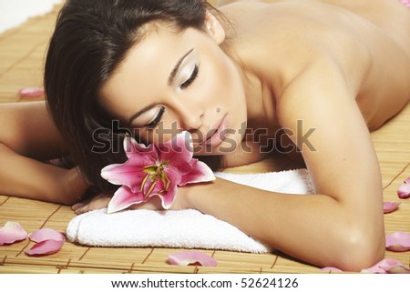 Portrait of Fresh and Beautiful brunette woman laying on bamboo mat