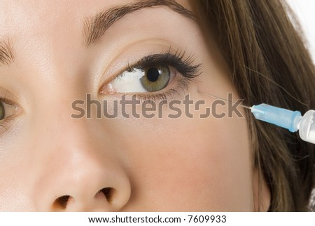 Portrait of fresh and beautiful woman getting a beauty injection