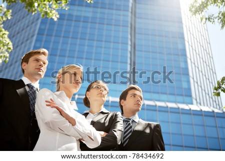 Portrait of friendly business group standing in line