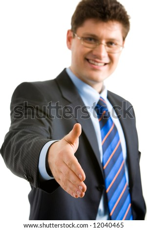 Portrait of friendly businessman giving his hand to a partner and looking at camera with smile