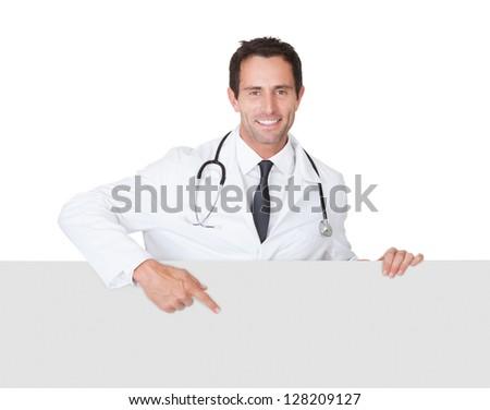 Portrait of friendly doctor presenting empty banner. Isolated on white