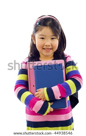 Portrait of friendly little asian girl, female student with backpack, blue book and notebook - isolated over a white background - stock photo