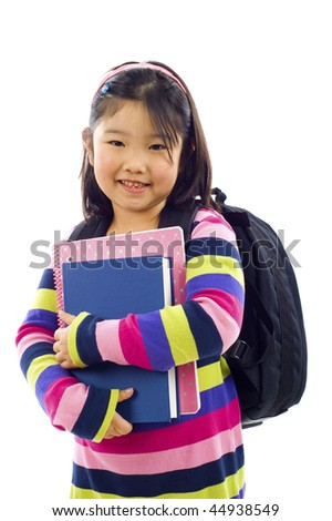 Portrait of  friendly little asian girl with backpack, blue book and notebook - isolated over a white background