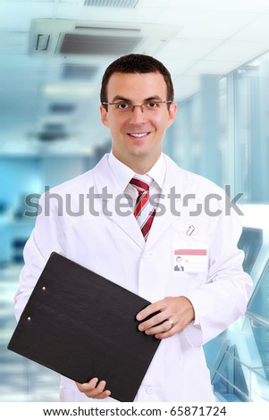 Portrait of friendly medical doctor medical pad.