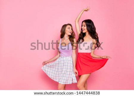 Portrait of friendly nice pretty charming nice youth person have holidays summer wear modern skirt stylish dress stretch raise hands arms wavy curly long hairdo isolated pink background