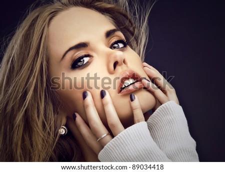 Portrait of friendly woman. Studio photo.