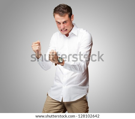 Portrait Of  Frustrated Young Man On Gray Background