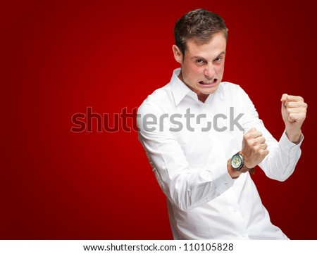 Portrait Of  Frustrated Young Man On Red Background