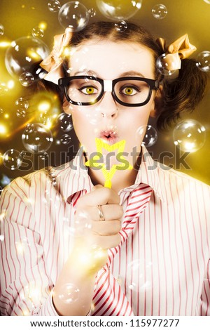 Portrait Of Fun Nerd Business Woman Blowing Soap Bubbles Through A Star In A Depiction Of Business Success