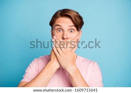 Portrait of funky guy tell private gossip impressed hide face close cover n\mouth palms wear modern summer clothes isolated over blue color background Foto stock ©