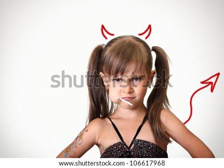 Portrait of funny angry child girl with candy, behavior concept
