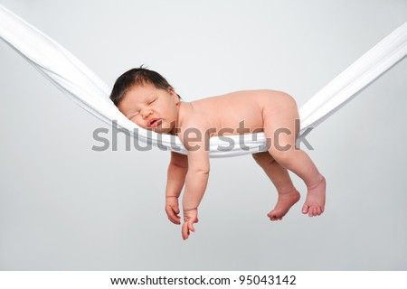 Portrait of funny baby relaxing in hammock