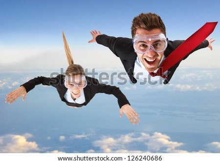 Portrait of funny business people skydiving - stock photo