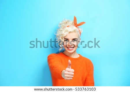 Portrait of funny emotional girl on blue background #533763103