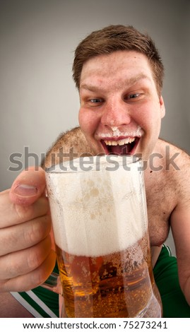 Portrait of funny fat man drinking beer
