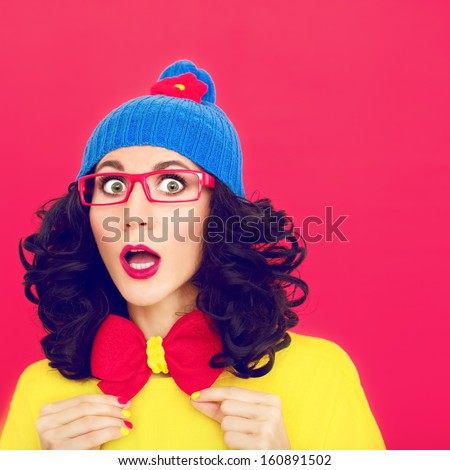 Portrait of funny girl surprised