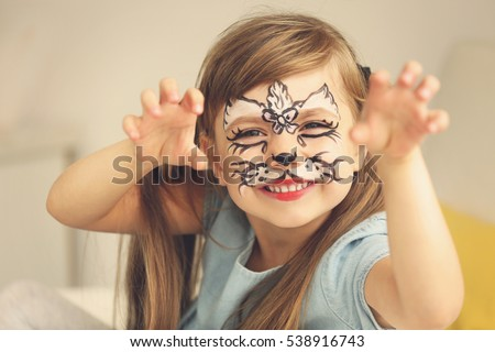 Portrait of funny girl with face painting on blurred background #538916743