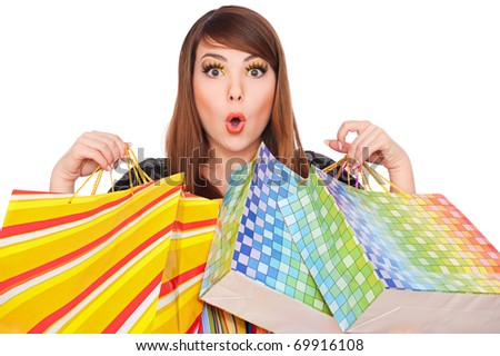 portrait of funny girl with shopping bags over white background - stock photo