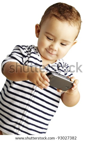 portrait of funny kid playing with mobile over white background