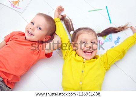 Portrait of funny little boy and a cute girl together