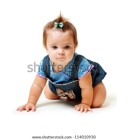 Portrait of funny lovely little baby girl looking to the camera sitting on white background