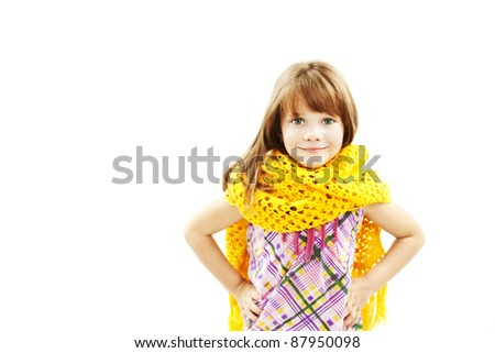 Portrait of funny lovely little girl wearing scarf. Isolated on white background