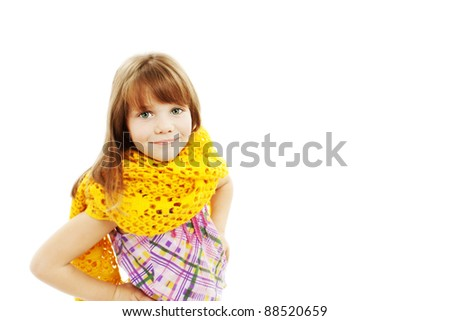 Portrait of funny lovely little girl wearing scarf. Isolated on white background - stock photo