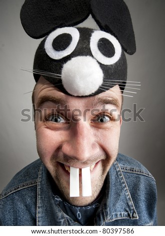 Portrait of funny man in rabbit hat