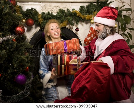 portrait of funny Santa with girlfriend