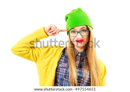 Portrait of Funny Street Style Hipster Girl in Glasses Going Crazy Isolated at White Background. Trendy Casual Fashion Outfit in Spring or Autumn. Bright and Vibrant Photo.