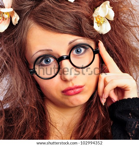 Portrait of funny woman in glasses