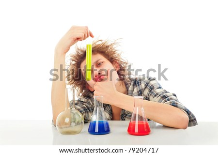 Portrait of funny young man with awesome hairdo isolated on white background. Working with color liquid in different glassware.