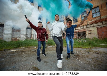 Portrait of furious strikers making rebel in ghetto
