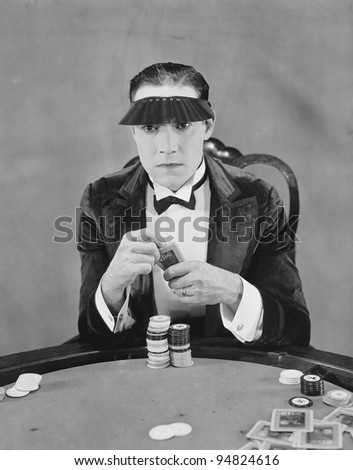 Portrait of gambler at card table