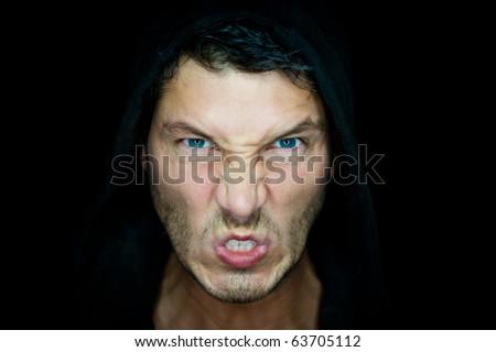 Portrait of gangster in darkness