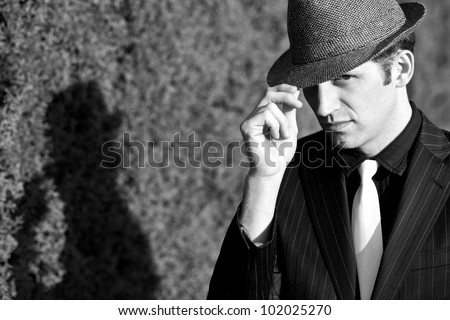 Portrait of gangster with hat and white tie