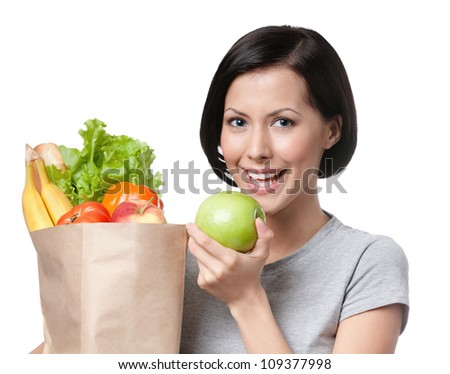 Portrait of girl eating an apple, isolated, white background