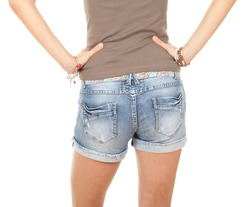 portrait of girl from back in trousers, jeans shorts, with brown casual shirt, series