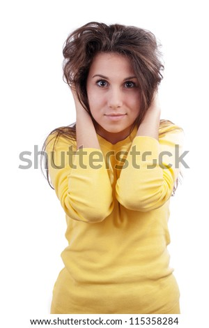 Portrait of girl holding hands on her head