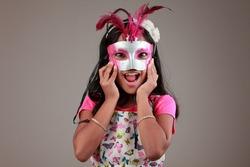 Portrait of girl holds a samba mask on face