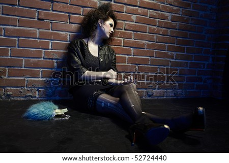 portrait of girl near brick wall