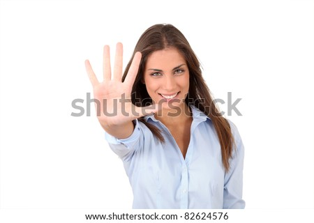 Portrait of girl showing hand to camera