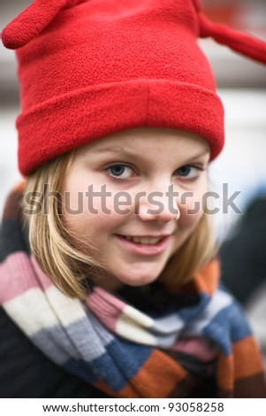 Portrait of girl wearing red knit hat