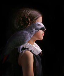 Portrait of Girl with African Gray Parrot