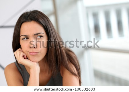 Portrait of girl with doubtful look on her face